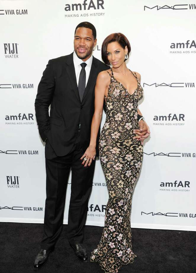 Television personality Michael Strahan, and girlfriend Nicole Murphy attend amfAR's New York gala at Cipriani Wall Street on Wednesday, Feb. 6, 2013 in New York. Photo: Evan Agostini, Evan Agostini/Invision/AP / Invision