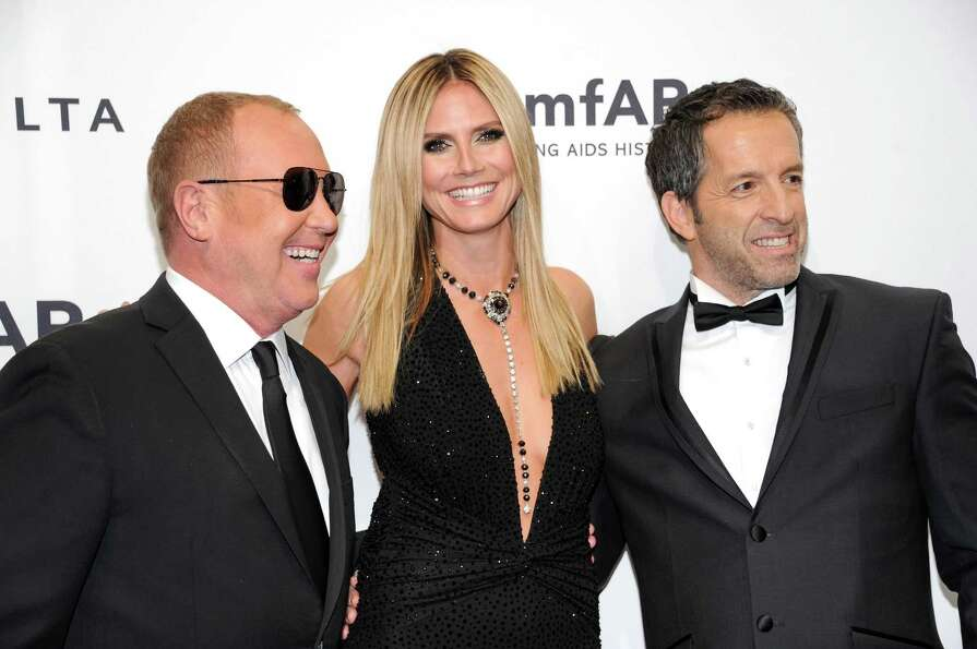 Designer Michael Kors, left, poses with honorees Heidi Klum and Kenneth Cole at amfAR's New York gal