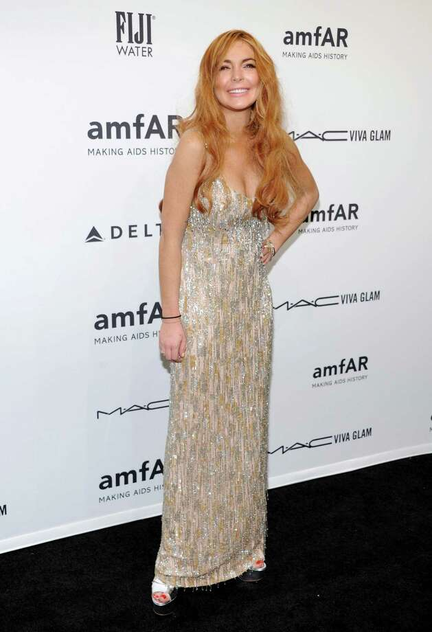 Actress Lindsay Lohan attends amfAR's New York gala at Cipriani Wall Street on Wednesday, Feb. 6, 2013 in New York. Photo: Evan Agostini, Evan Agostini/Invision/AP / Invision