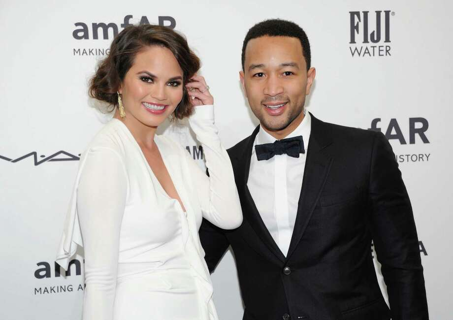 Singer John Legend and fiancee, model Chrissy Teigen, attend amfAR's New York gala at Cipriani Wall Street on Wednesday, Feb. 6, 2013 in New York. Photo: Evan Agostini, Evan Agostini/Invision/AP / Invision