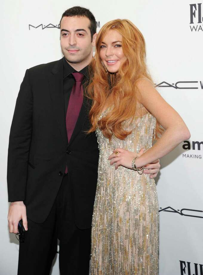 Producer Mohammed Al Turki and actress Lindsay Lohan attend amfAR's New York gala at Cipriani Wall Street on Wednesday, Feb. 6, 2013 in New York. Photo: Evan Agostini, Evan Agostini/Invision/AP / Invision