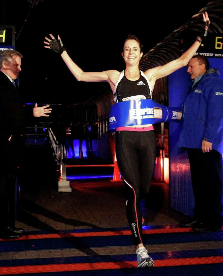 Suzy Walsham, of Australia, wins the women's invitational of the Empire State Building Run-Up, Wednesday, Feb. 6, 2013, in New York. Photo: Frank Franklin II, AP / AP