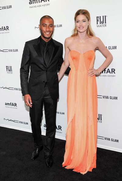 Model Doutzen Kroes, right, and husband Sunnery James attend amfAR's New York gala at Cipriani Wall