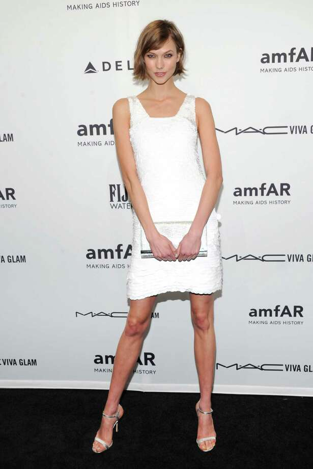 Model Karlie Kloss attends amfAR's New York gala at Cipriani Wall Street on Wednesday, Feb. 6, 2013 in New York. Photo: Evan Agostini, Evan Agostini/Invision/AP / Invision