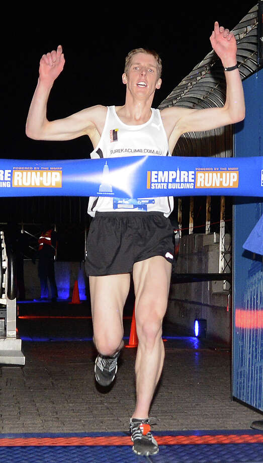 Australia's Mark Bourne crosses the finish line winning the 36th annual Empire State Building run-up in New York, February 6, 2013. Some 600 competitors entered the race which consist of racing up 86 floors, 1,576 steps, and 1,050 feet from the lobby to the iconic 86th floor Observatory. AFP PHOTO/Emmanuel DunandEMMANUEL DUNAND/AFP/Getty Images Photo: EMMANUEL DUNAND, AFP/Getty Images / AFP