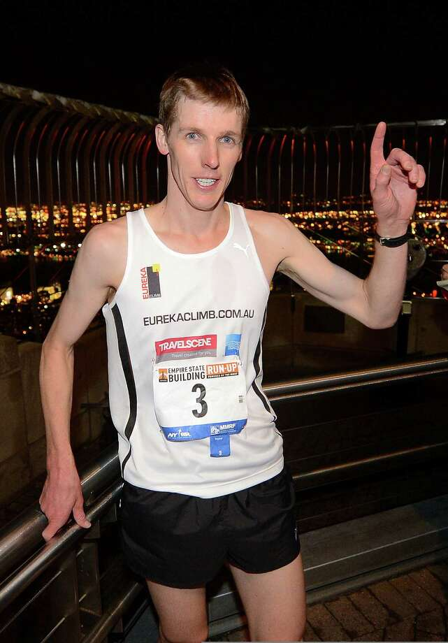 Australia's Mark Bourne celebrates after crossing the finish line winning the 36th annual Empire State Building run-up in New York, February 6, 2013. Some 600 competitors entered the race which consist of racing up 86 floors, 1,576 steps, and 1,050 feet from the lobby to the iconic 86th floor Observatory. AFP PHOTO/Emmanuel DunandEMMANUEL DUNAND/AFP/Getty Images Photo: EMMANUEL DUNAND, AFP/Getty Images / AFP