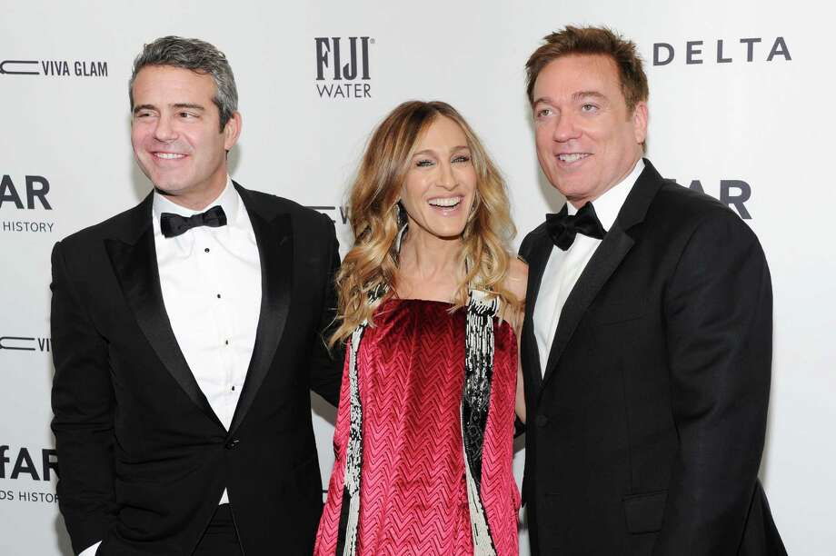Television personality Andy Cohen, left, poses with honorees actress Sarah Jessica Parker and agent Kevin Huvane at amfAR's New York gala at Cipriani Wall Street on Wednesday, Feb. 6, 2013 in New York. Photo: Evan Agostini, Evan Agostini/Invision/AP / Invision