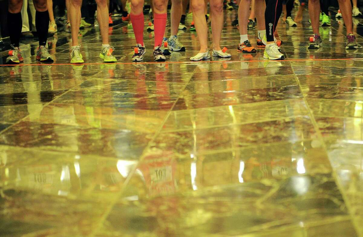 Competitors get ready to start the 36th annual Empire State Building run-up in New York, February 6, 2013. Some 600 competitors entered the race which consist of racing up 86 floors, 1,576 steps, and 1,050 feet from the lobby to the iconic 86th floor Observatory. AFP PHOTO/Emmanuel DunandEMMANUEL DUNAND/AFP/Getty Images