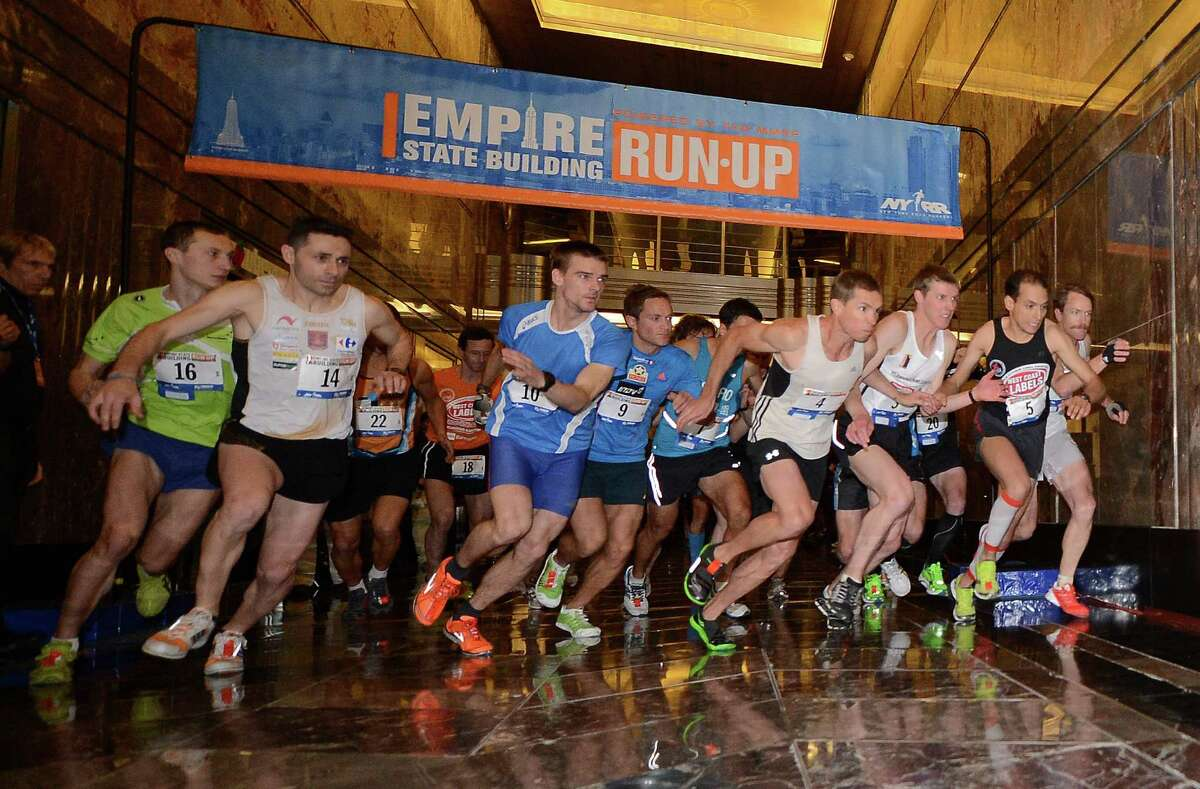 Competitors starts the 36th annual Empire State Building run-up in New York, February 6, 2013. Some 600 competitors entered the race which consist of racing up 86 floors, 1,576 steps, and 1,050 feet from the lobby to the iconic 86th floor Observatory. AFP PHOTO/Emmanuel DunandEMMANUEL DUNAND/AFP/Getty Images