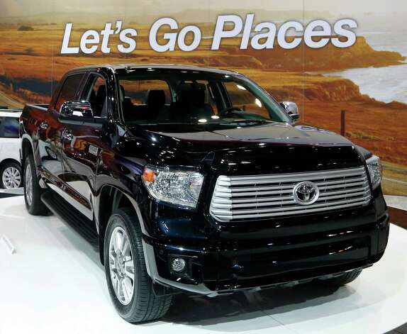 The redesigned 2014 Toyota Tundra is unveiled at the Chicago Auto Show Thursday, Feb. 7, 2013, in Chicago. (AP Photo/Charles Rex Arbogast) Photo: Charles Rex Arbogast, Associated Press / AP