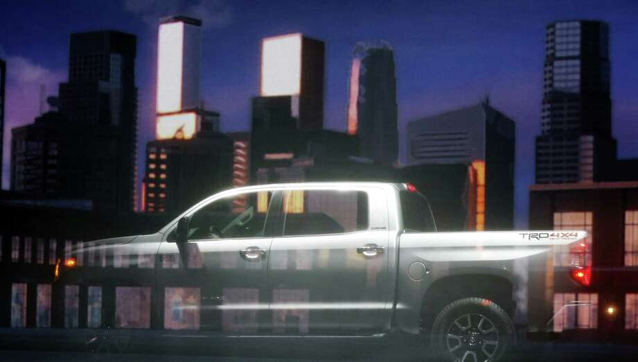 The redesigned 2014 Toyota Tundra is photographed behind a projection screen during its unveiling at the Chicago Auto Show Thursday, Feb. 7, 2013, in Chicago. (AP Photo/Charles Rex Arbogast) Photo: Charles Rex Arbogast, Associated Press / AP