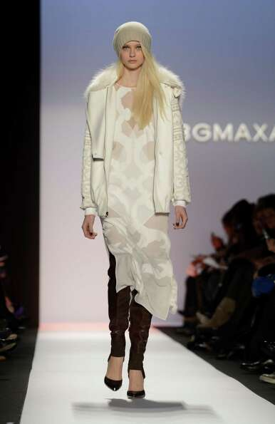 A model wears designs by BCBGMaxAzria during the Mercedes-Benz Fashion Week Fall 2013 collections on