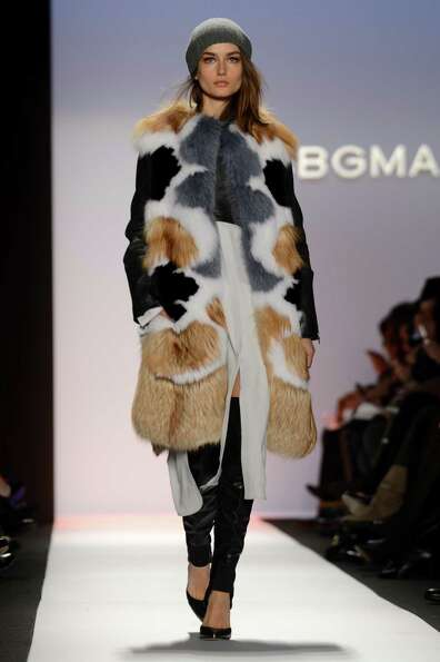 A model wears designs by BCBGMaxAzria during the Mercedes-Benz Fashion Week Fall 2013 collections o