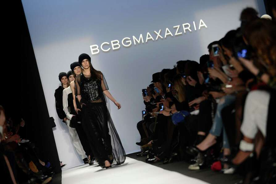 Models wear designs by BCBGMaxAzria during the Mercedes-Benz Fashion Week Fall 2013 collections on F