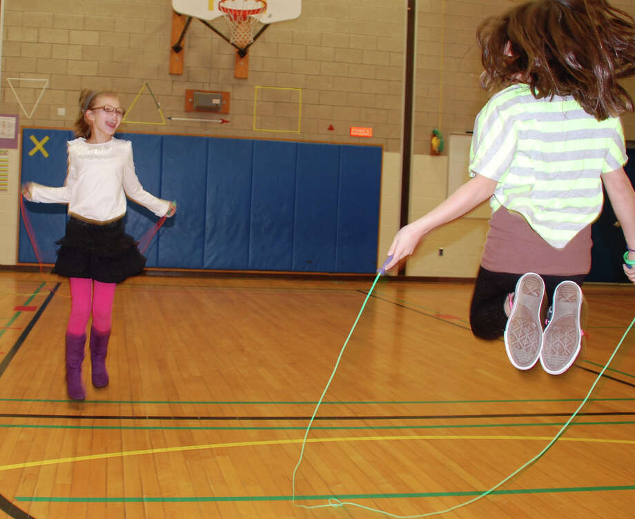 Samantha Epperson, 9, left, and Holly Casey, 9, are among the students who routinely start the day by jumping rope at Holland Hill School.  FAIRFIELD CITIZEN, CT 2/5/13 Photo: Jarret Liotta / Fairfield Citizen contributed