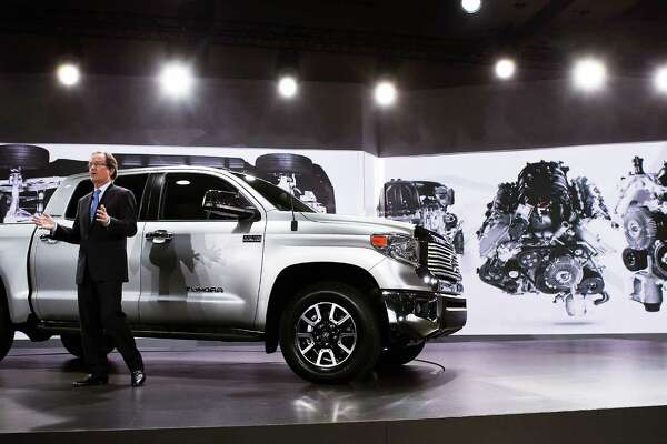 Bill Fay, Toyota's group vice president and general manager, introduces the 2014 Tundra full-size truck at the Chicago Auto Show on Thursday.