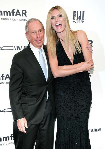 New York Mayor Michael Bloomberg and honoree Heidi Klum attend amfAR's New York gala at Cipriani Wal