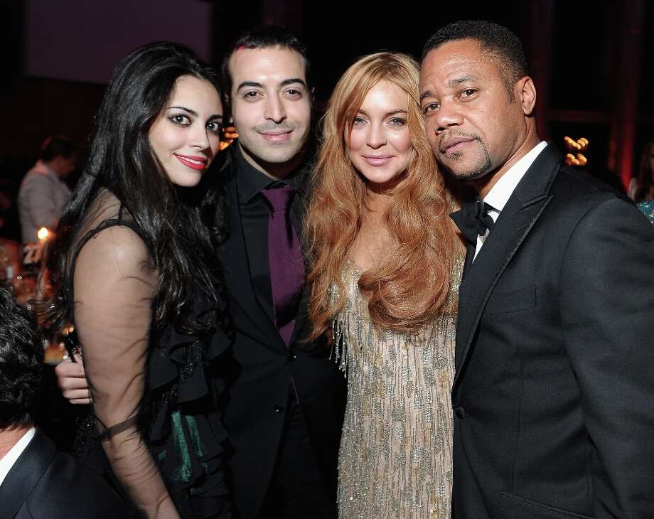 (L-R) Guest,  Mohammed Al Turki, Lindsay Lohan, and Cuba Gooding Jr. attend the amfAR New York Gala to kick off Fall 2013 Fashion Week at Cipriani Wall Street on February 6, 2013 in New York City.  (Photo by Michael Loccisano/Getty Images for Mercedes-Benz Fashion Week) Photo: Michael Loccisano, (Credit Too Long, See Caption) / 2013 Getty Images