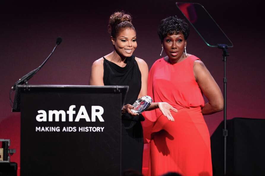 Janet Jackson (L) and Maria Davis speak onstage at the amfAR New York Gala to kick off Fall 2013 Fas