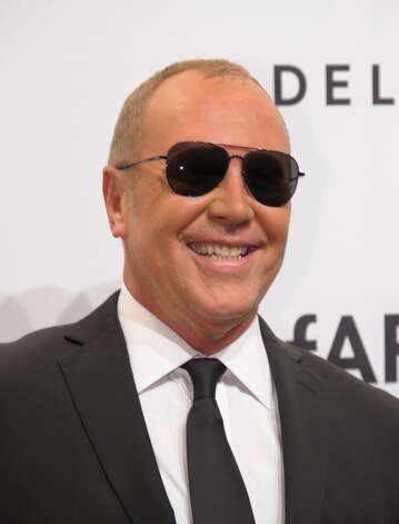 Designer Michael Kors arrives at the amfAR (The Foundation for AIDS Research) gala that kicks off the Mercedes-Benz Fashion Week February 6, 2013 in New York. Photo: STAN HONDA, AFP/Getty Images / AFP