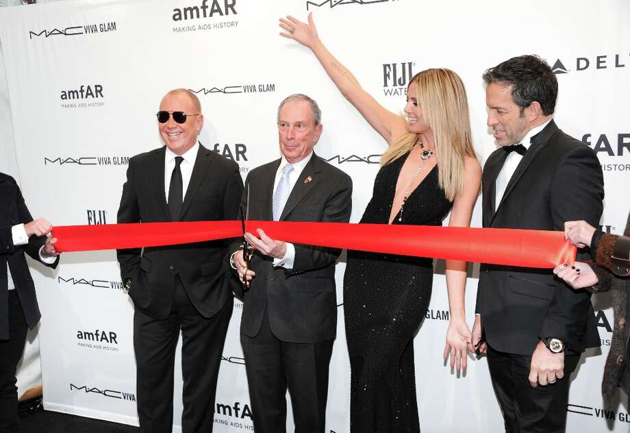 New York Mayor Michael Bloomberg cuts the ribbon to kick off Mercedes-Benz New York fashion week with designer Michael Kors, left, and honorees Heidi Klum and Kenneth Cole at amfAR's New York gala at Cipriani Wall Street on Wednesday, Feb. 6, 2013 in New York. (Photo by Evan Agostini/Invision/AP) Photo: Evan Agostini, Associated Press / Invision