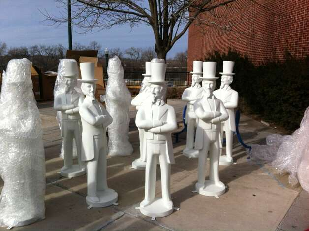 A collection of Uncle Sam statues are unloaded in Troy on Thursday, Feb. 7, 2013. The statues will be painted by local artists and displayed around the city. (Kenneth C. Crowe II/Times Union)