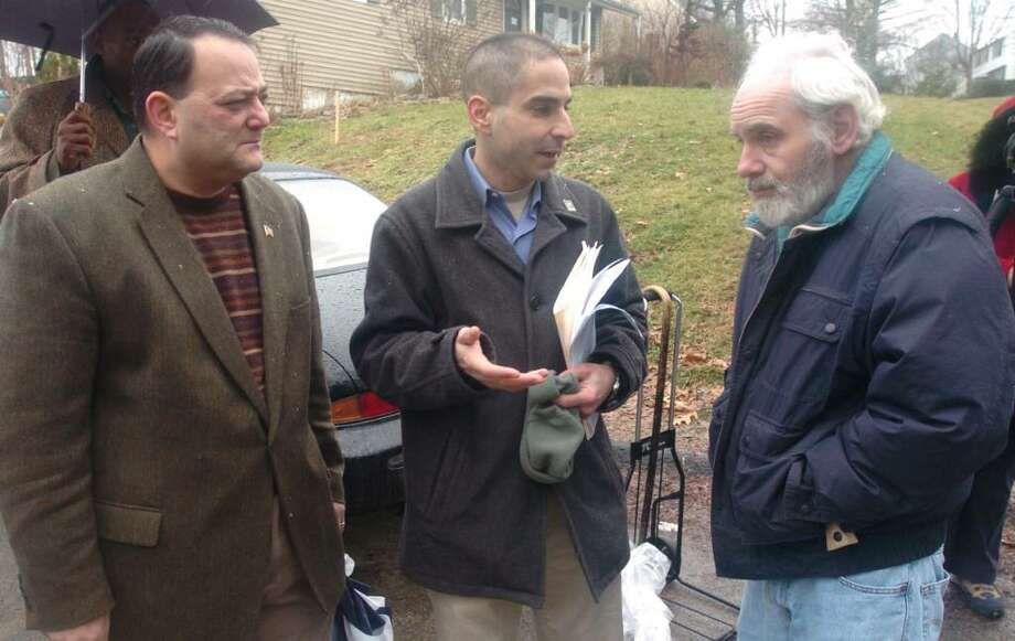 From left, Ben Chianese, Danbury City Council, Thomas Saadi, Danbury City Council, and Peter Taubenblatt, of Danbury, all talk about construction on Hospital Ave, Monday, Dec. 28, 2009. Photo: Chris Ware / The News-Times