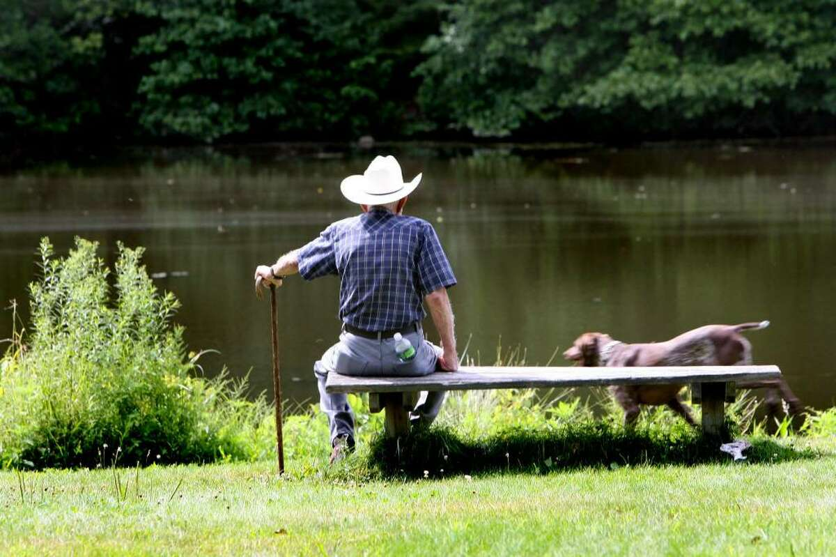 Sam Lisi, of Stratford, spends an August afternoon in Wooster Park with his dog, Daisey.