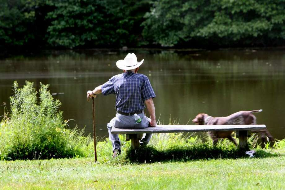 Sam Lisi, of Stratford, spends an August afternoon in Wooster Park with his dog, Daisey. Photo: B.K. Angeletti / Connecticut Post Freelance