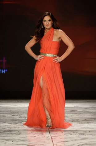 Actress Minka Kelly walks the runway at The Heart Truth 2013 Fashion Show at Hammerstein Ballroom. Photo: Frazer Harrison, Getty / 2013 Getty Images
