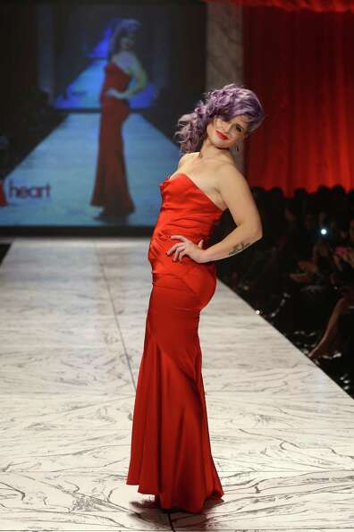 Actress Kelly Osbourne walks the runway at The Heart Truth 2013 Fashion Show.