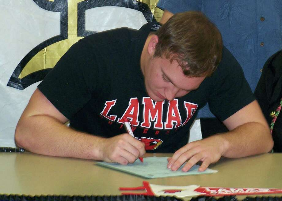 Nederland football player Koby Couron signed with Lamar University on Wednesday, Feb. 6, 2013. Photo: Courtesy Of Kevin Couron