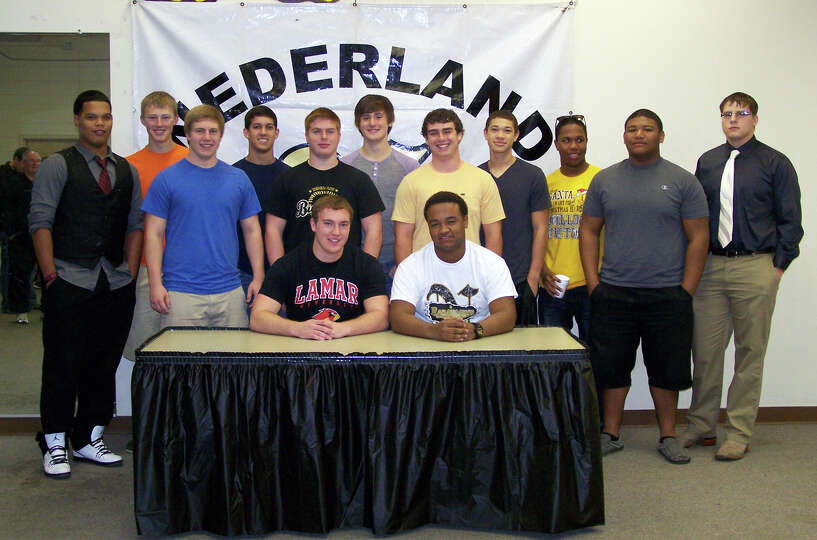 Nederland football player Koby Couron signed with Lamar University on Wednesday, Feb. 6, 2013.