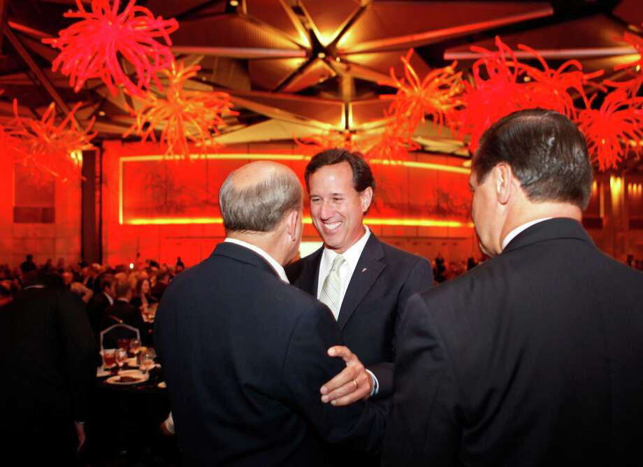 Former presidential candidate  Rick Santorum, center, greets Louie Gohmert, center left, during Gala Banquet of the Republican Party of Texas State Convention at the Fort Worth Convention Center in Fort Worth, TX on June 8, 2012. (Kye R. Lee/The Dallas Morning News) Photo: Kye R. Lee, Staff Photographer / 10013976A