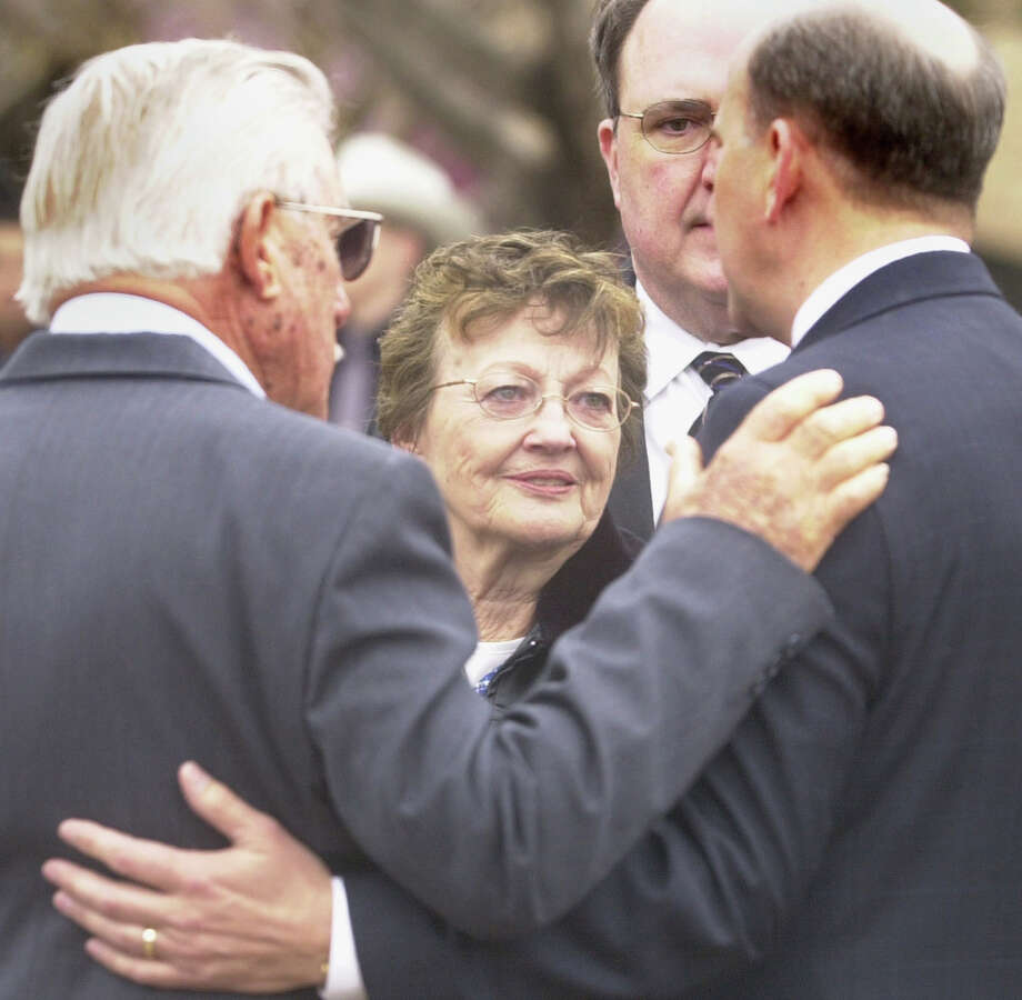 Rep. Louie Gohmert, R-Tyler, right, talks with Lynn Stewart, facing center, mother of the late Mark Wilson, before a memorial service Sunday, Feb. 27, 2005, at T.B. Butler Plaza in Tyler, Texas. Wilson, who served in the Navy from 1973 to 1977, was killed in a shootout with David Hernandez Arroyo Sr., Thursday afternoon on the Smith County Courthouse square. Photo: HERB NYGREN JR, AP / TYLER MORNING TELEGRAPH