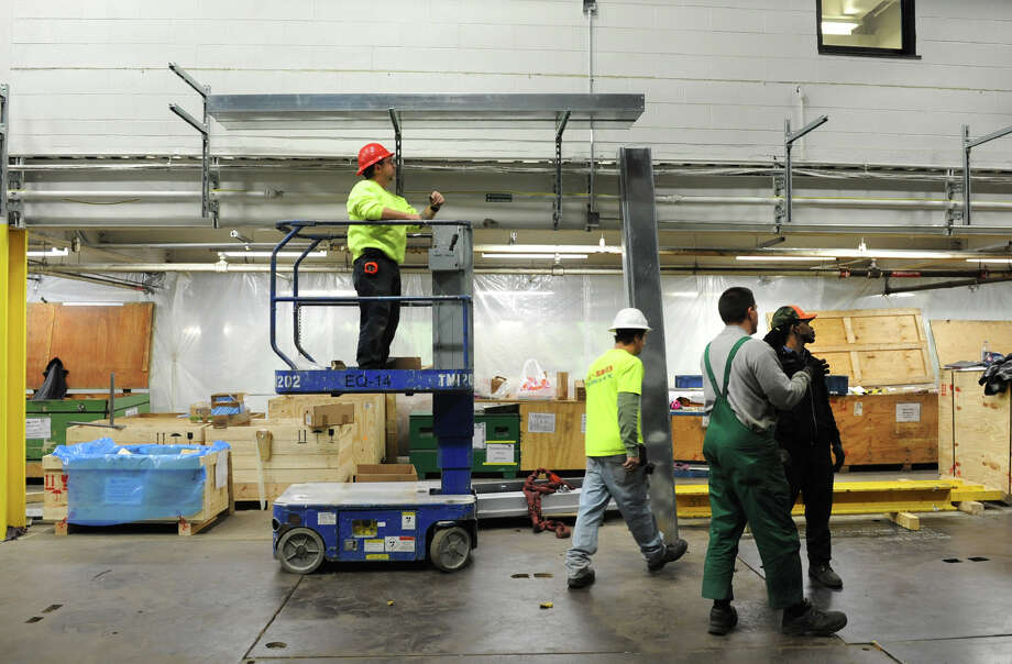 Work continues on the assembly of the new press at the Times Union on Friday Dec. 7, 2012 in Colonie, N.Y.  (Lori Van Buren / Times Union) Photo: Lori Van Buren