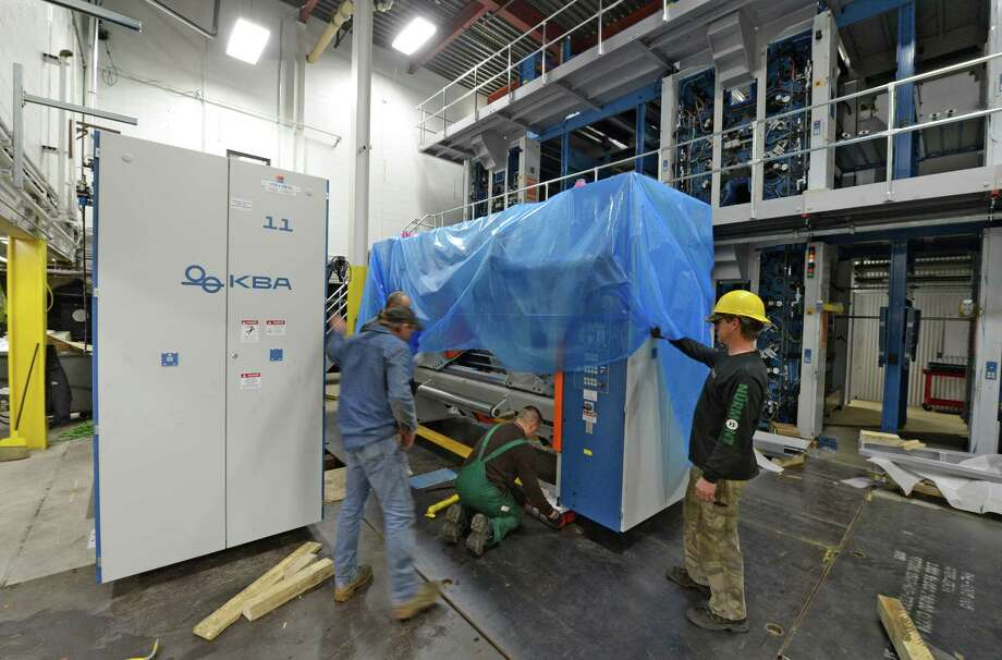 Installation of the new KBA presses continues today Dec 10, 2012.      (Skip Dickstein/Times Union) Photo: Skip Dickstein / 00019511A