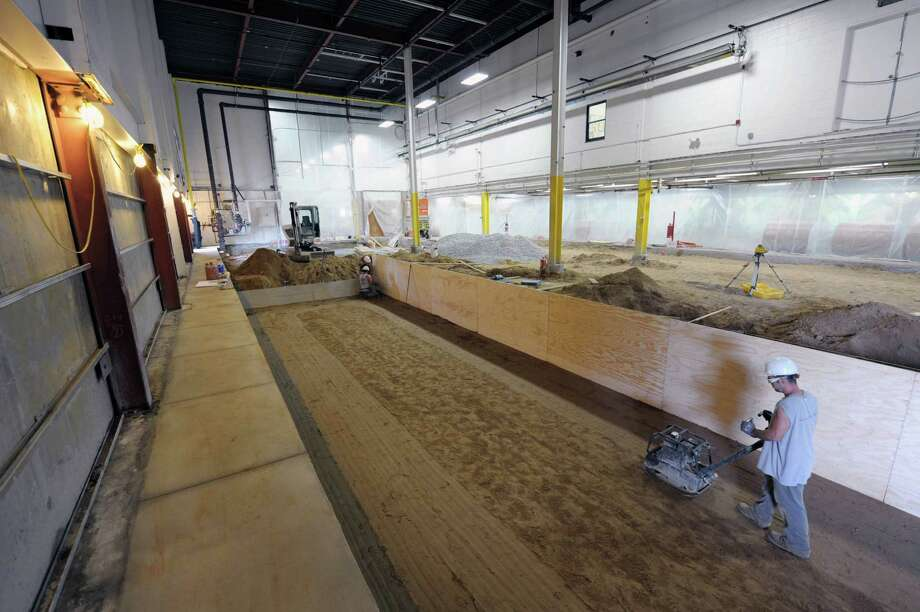 Workers prepare the area where five feet of concrete will be poured as work continues on the new press at the Times Union on Wednesday, July 18, 2012 in Colonie, NY.  The concrete will be poured in two separate pours to get to the five feet in total.  (Paul Buckowski / Times Union) Photo: Paul Buckowski