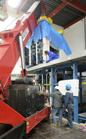 Installation of the upper printing units of the new KBA presses began today Nov 19, 2012.      (Skip Dickstein/Times Union) Photo: Skip Dickstein / 00019513A