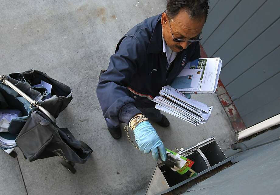 Juan Padilla soon may not be delivering mail in S.F. on Saturdays. Photo: Justin Sullivan, Getty Images