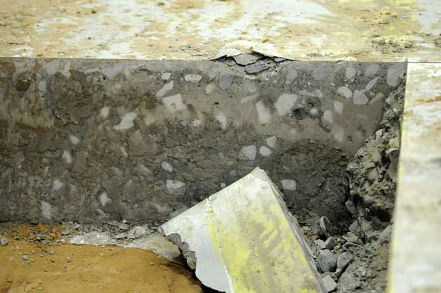 A cross section of part of the concrete floor that workers are removing from the old paper storage room as part of preparations for the new press at the Times Union,  on Wednesday June 27, 2012 in Colonie, NY. (Philip Kamrass / Times Union) Photo: Philip Kamrass / 00018281A