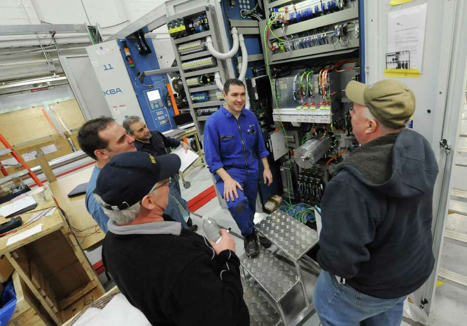 Times Union machinists and electricians get instruction on the new printing press at the Times Union on Tuesday Jan. 29, 2013 in Colonie, N.Y.  (Lori Van Buren / Times Union) Photo: Lori Van Buren