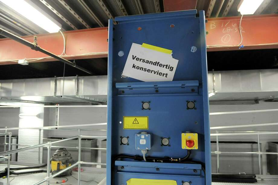 "A sign in German translates to ""dispatch conserved"" on the new printing press at the Times Union on Tuesday Jan. 29, 2013 in Colonie, N.Y.  (Lori Van Buren / Times Union) Photo: Lori Van Buren"