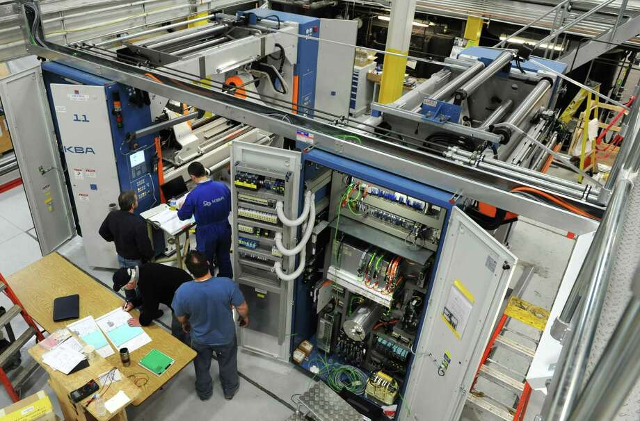 Times Unionmachinists and electriciansget instruction on the new printing press at the Times Union on Tuesday Jan. 29, 2013 in Colonie, N.Y.  (Lori Van Buren / Times Union) Photo: Lori Van Buren