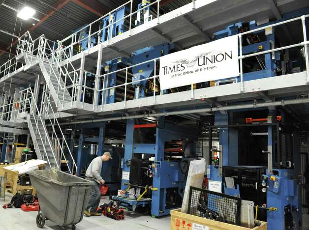 KBA technicians continue work on the new press at the Times Union in Colonie Wednesday Jan. 9, 2013.  (John Carl D'Annibale / Times Union) Photo: John Carl D'Annibale / 00020708A