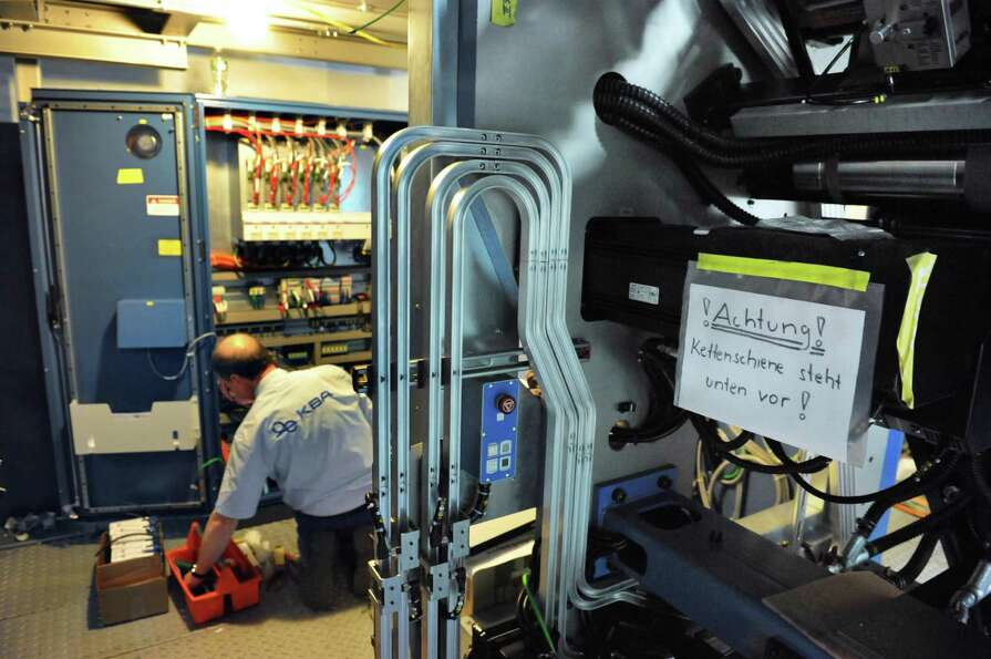 KBA technicians continue work on the new press at the Times Union in Colonie Wednesday Jan. 9, 2013.