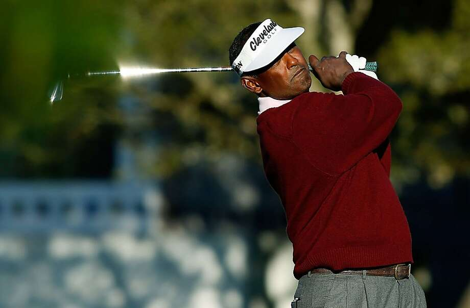 PEBBLE BEACH, CA - FEBRUARY 07:  Vijay Singh of Fiji watches his approach shot on the first hole during the first round of the AT&T Pebble Beach National Pro-Am at Pebble Beach Golf Links on February 7, 2013 in Pebble Beach, California.  (Photo by Scott Halleran/Getty Images) Photo: Scott Halleran, Getty Images