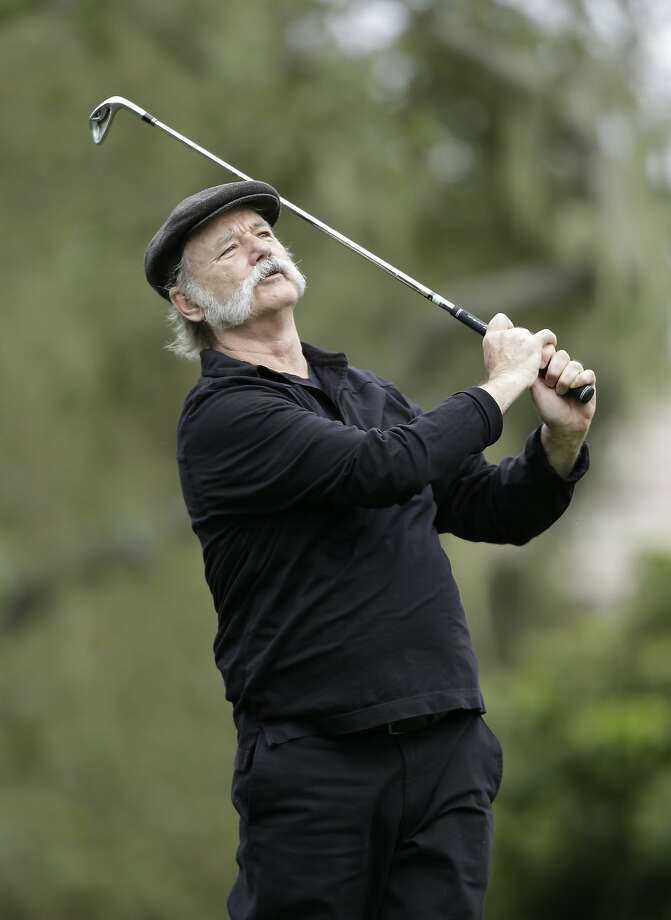 Actor Bill Murray follows his shot from the third tee of the Monterey Peninsula Country Club Shore Course during the first round of the AT&T Pebble Beach Pro-Am golf tournament Thursday, Feb. 7, 2013, in Pebble Beach, Calif. (AP Photo/Ben Margot) Photo: Ben Margot, Associated Press