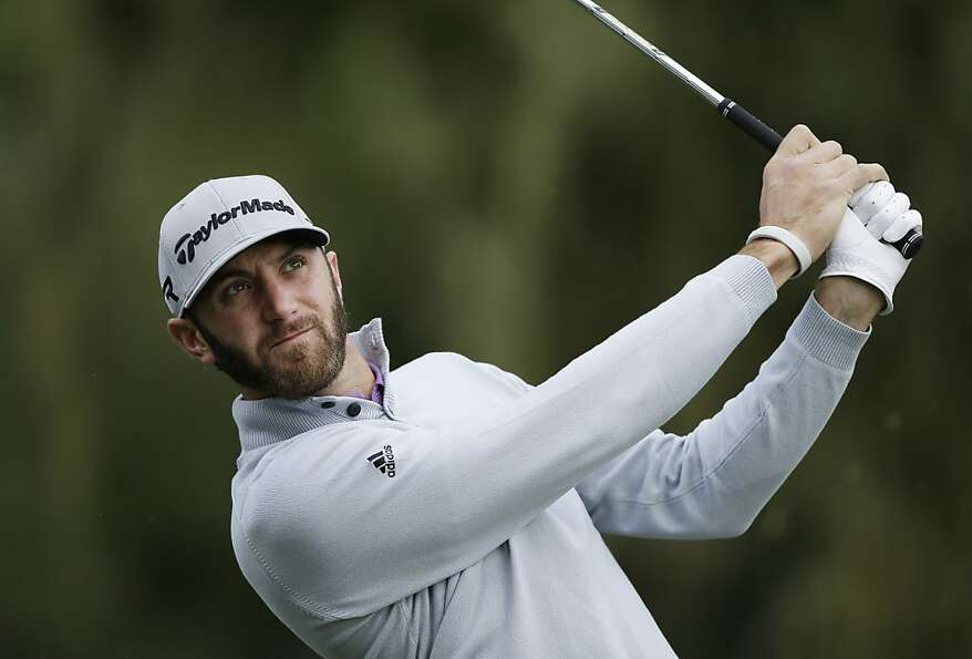 Dustin Johnson follows his shot from the third tee of the Monterey Peninsula Country Club Shore Cour