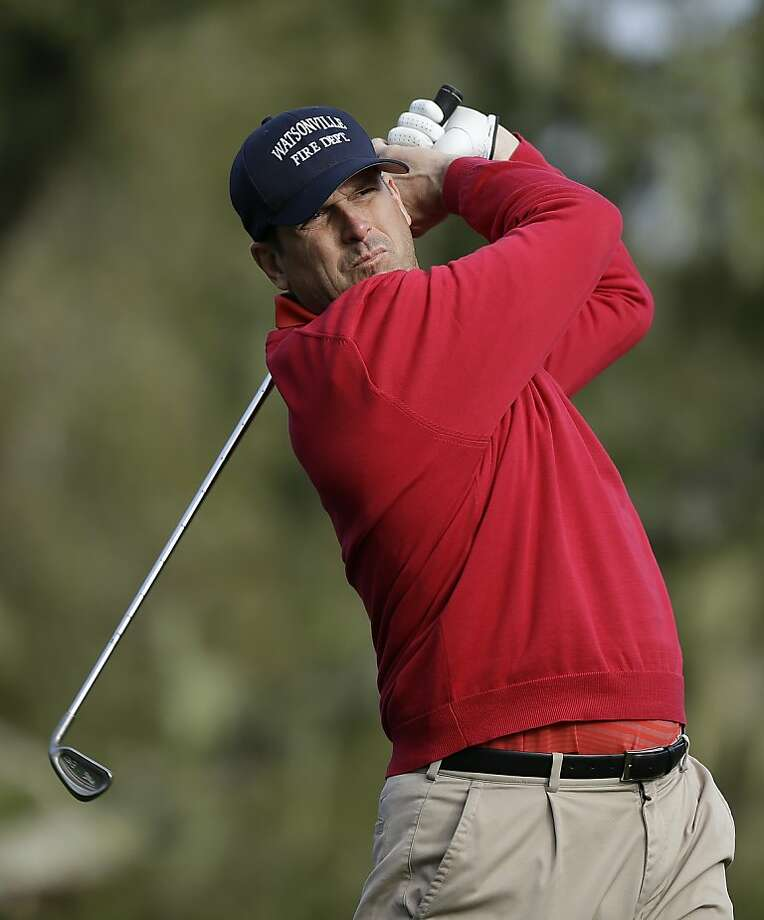 San Francisco 49ers head coach Jim Harbaugh follows his shot from the third tee of the Monterey Peninsula Country Club Shore Course during the first round of the AT&T Pebble Beach Pro-Am golf tournament Thursday, Feb. 7, 2013, in Pebble Beach, Calif. (AP Photo/Ben Margot) Photo: Ben Margot, Associated Press